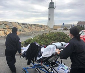 Brewster Ambulance Service EMTs Brian Costa and Era Koroveshi drove the ambulance for over an hour to fulfill a hospice patient's wish to see a lighthouse before she died. (Photo/BAS)