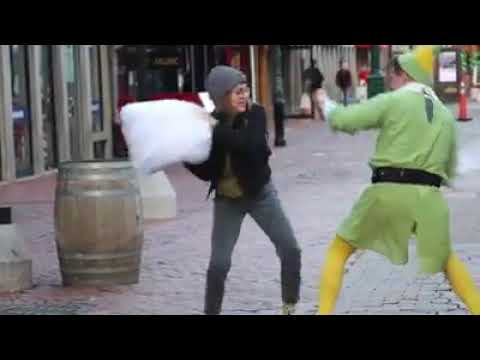 Firefighter dressed as Buddy the Elf challenges Bostonians to pillow fights in the city